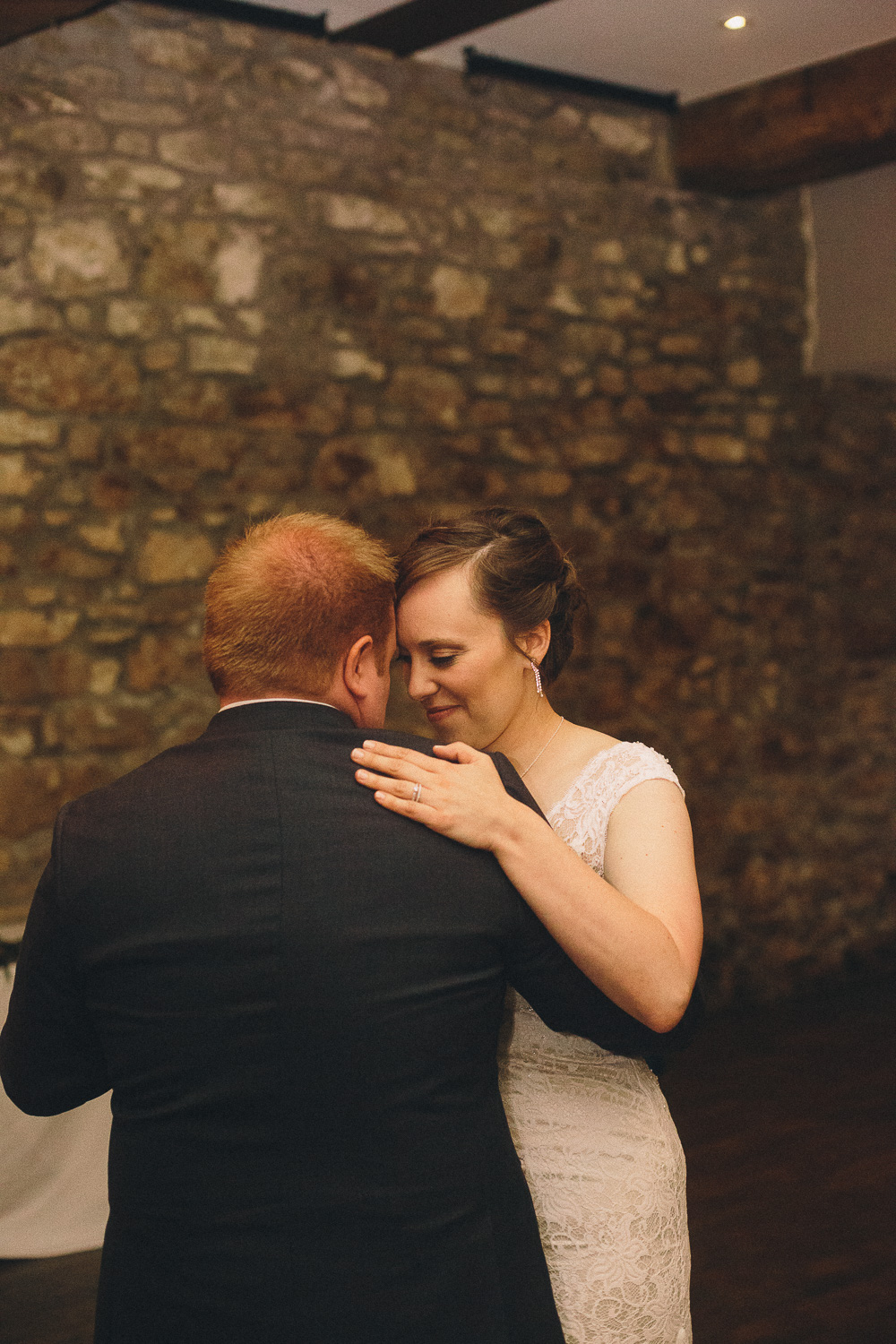 Bride with short hair shares the first dance with her groom during their summer wedding at Cambridge Mill