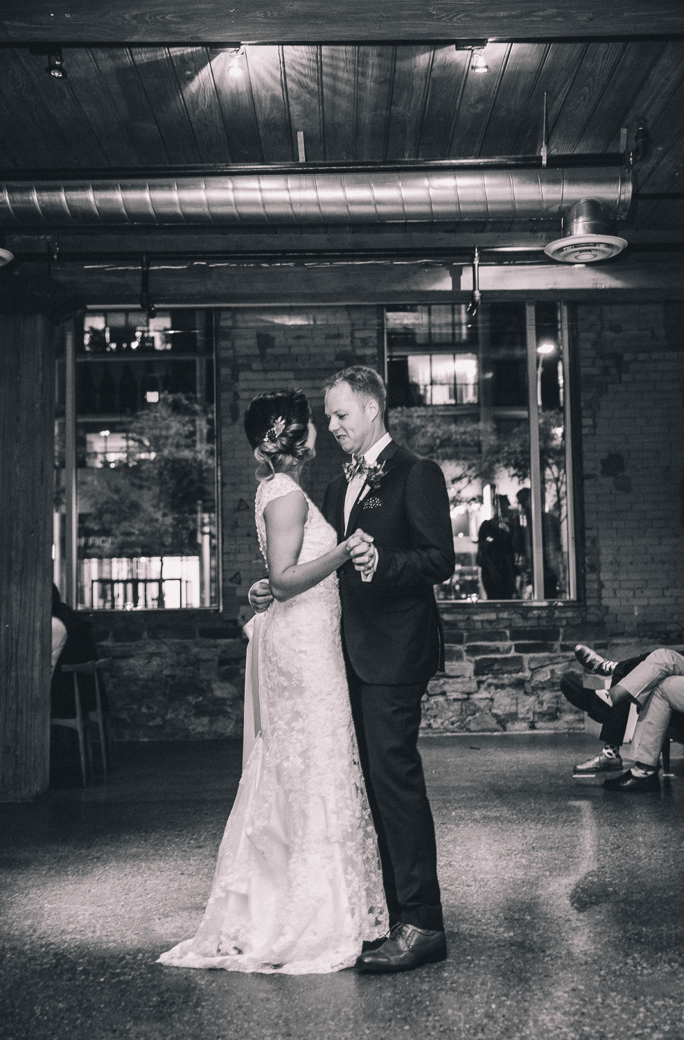 Interracial couple share their first dance during their summer wedding at Hotel Ocho