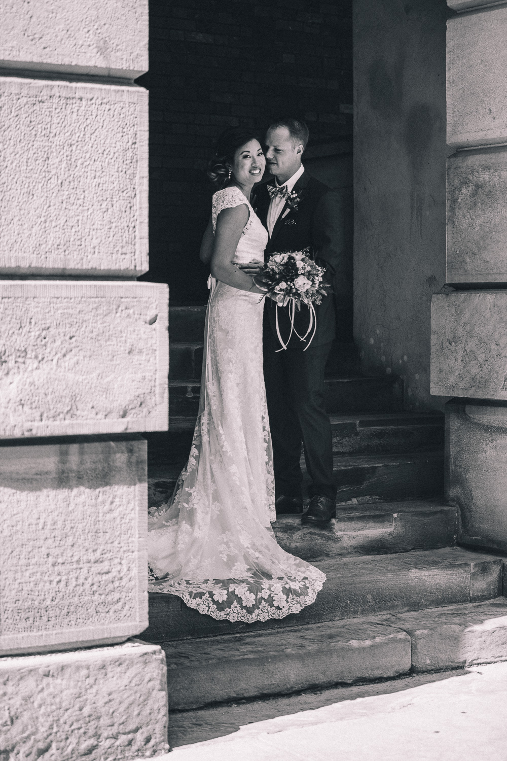 Interracial wedding couple embrace during their non religious wedding at Osgoode Hall