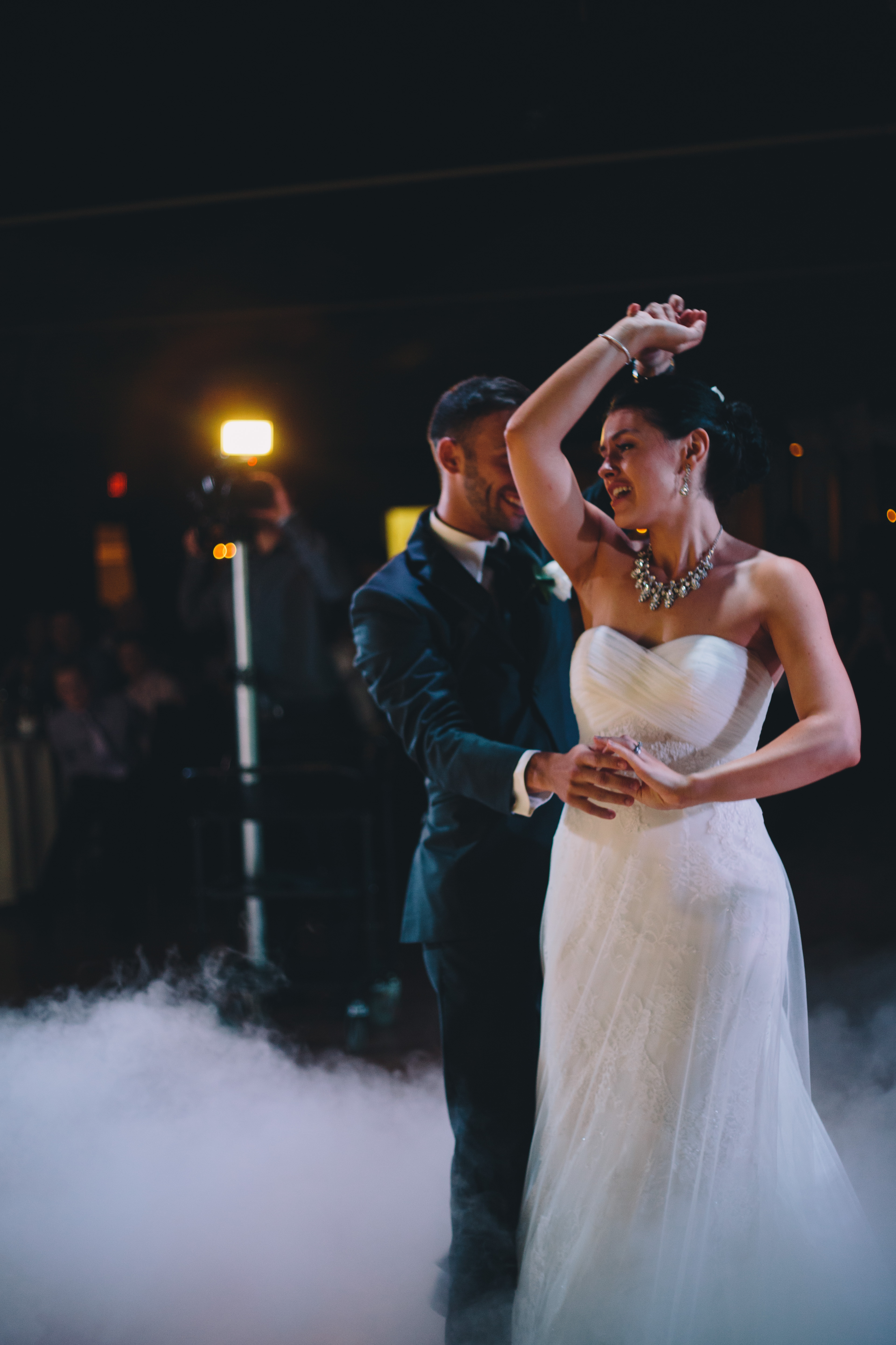 A smoke machine fills the dancefloor of this Jewish wedding as the Bride and groom share their first dance as husband and wife at the Palais Royale in Toronto, Ontario