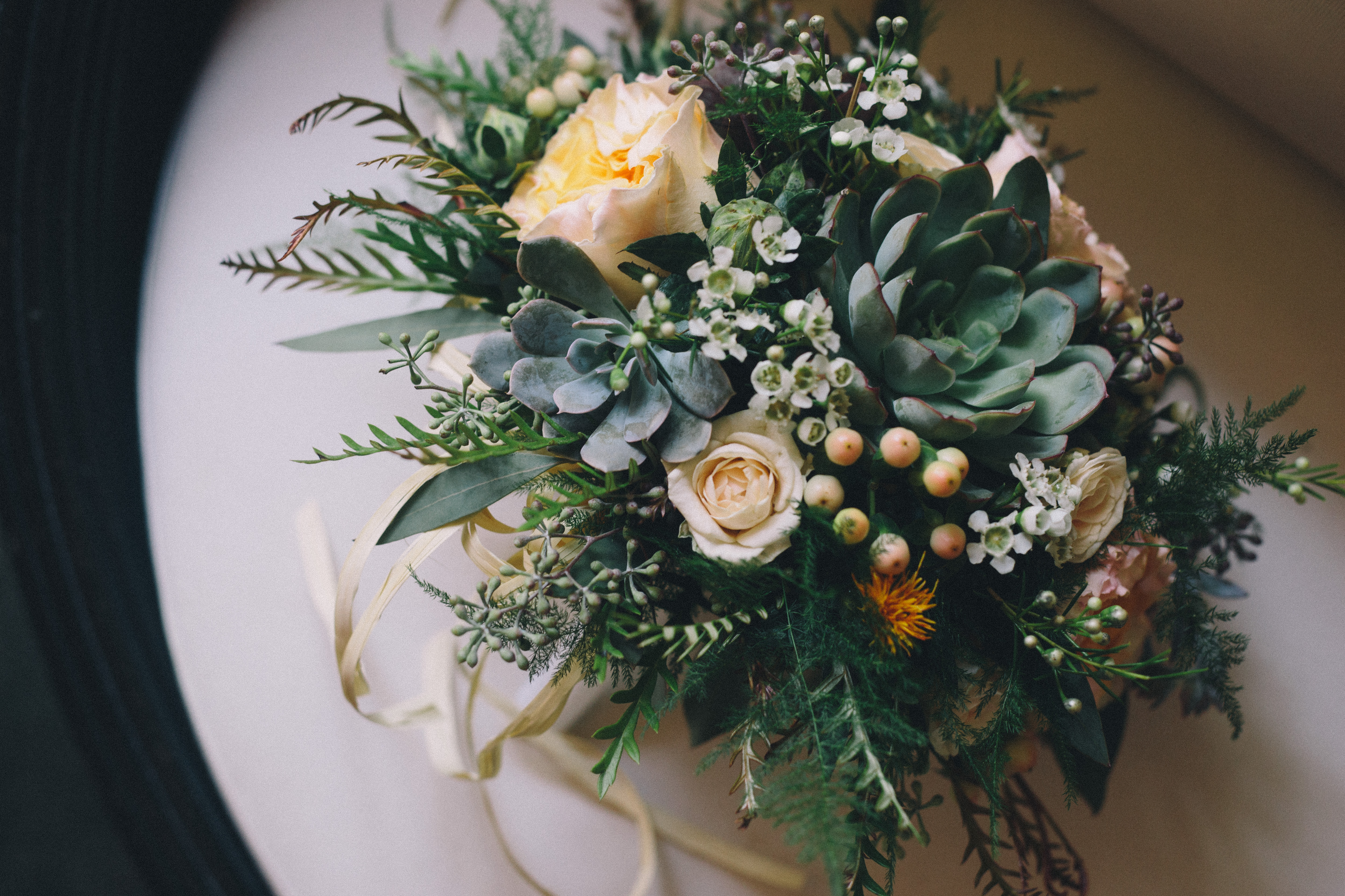 Succulent bridal bouquet with peach blooms and summer greenery at Hotel Ocho in Toronto