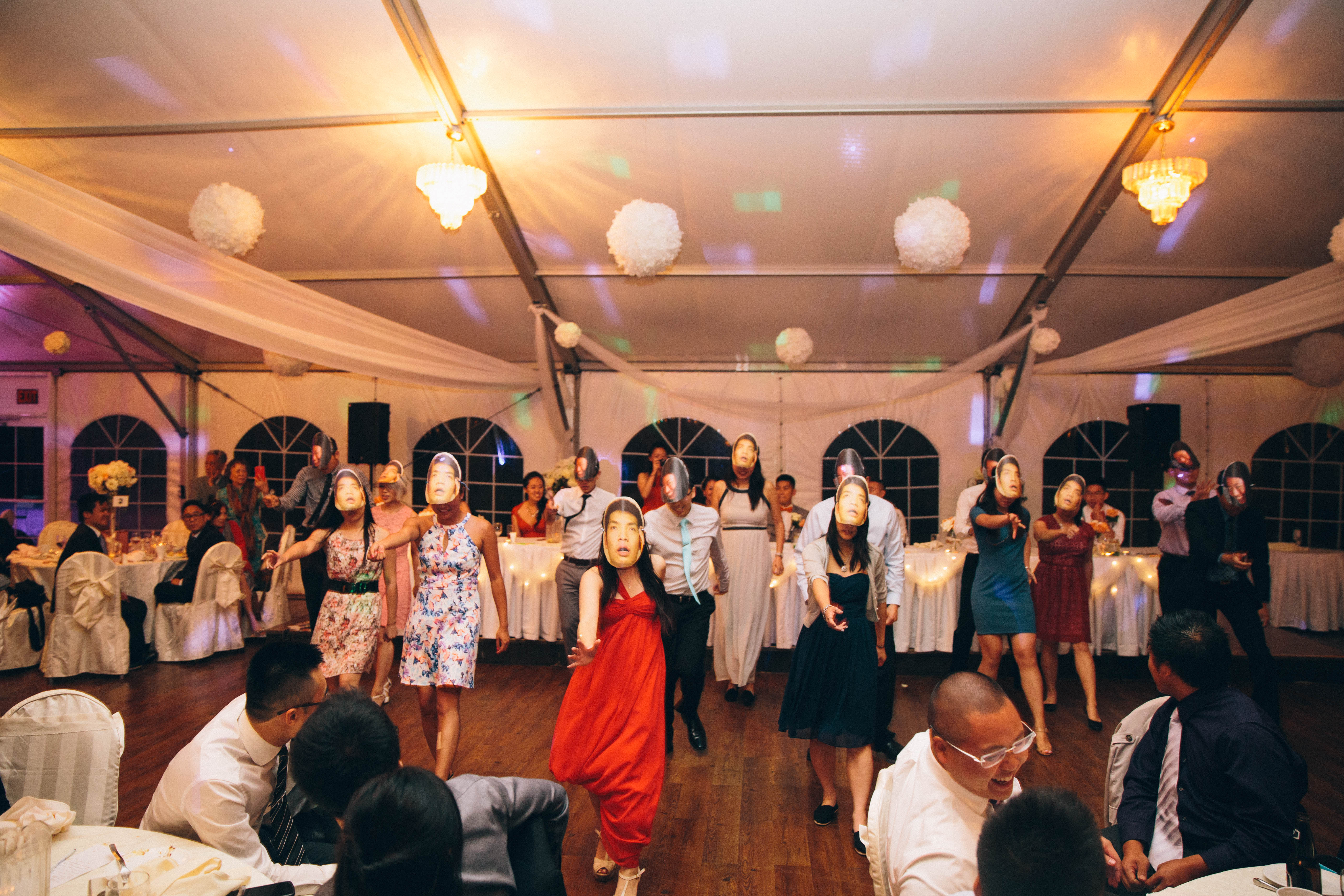 Flash mob dancing with bride's and groom's faces as masks at wedding reception at the Mandarin Country Club