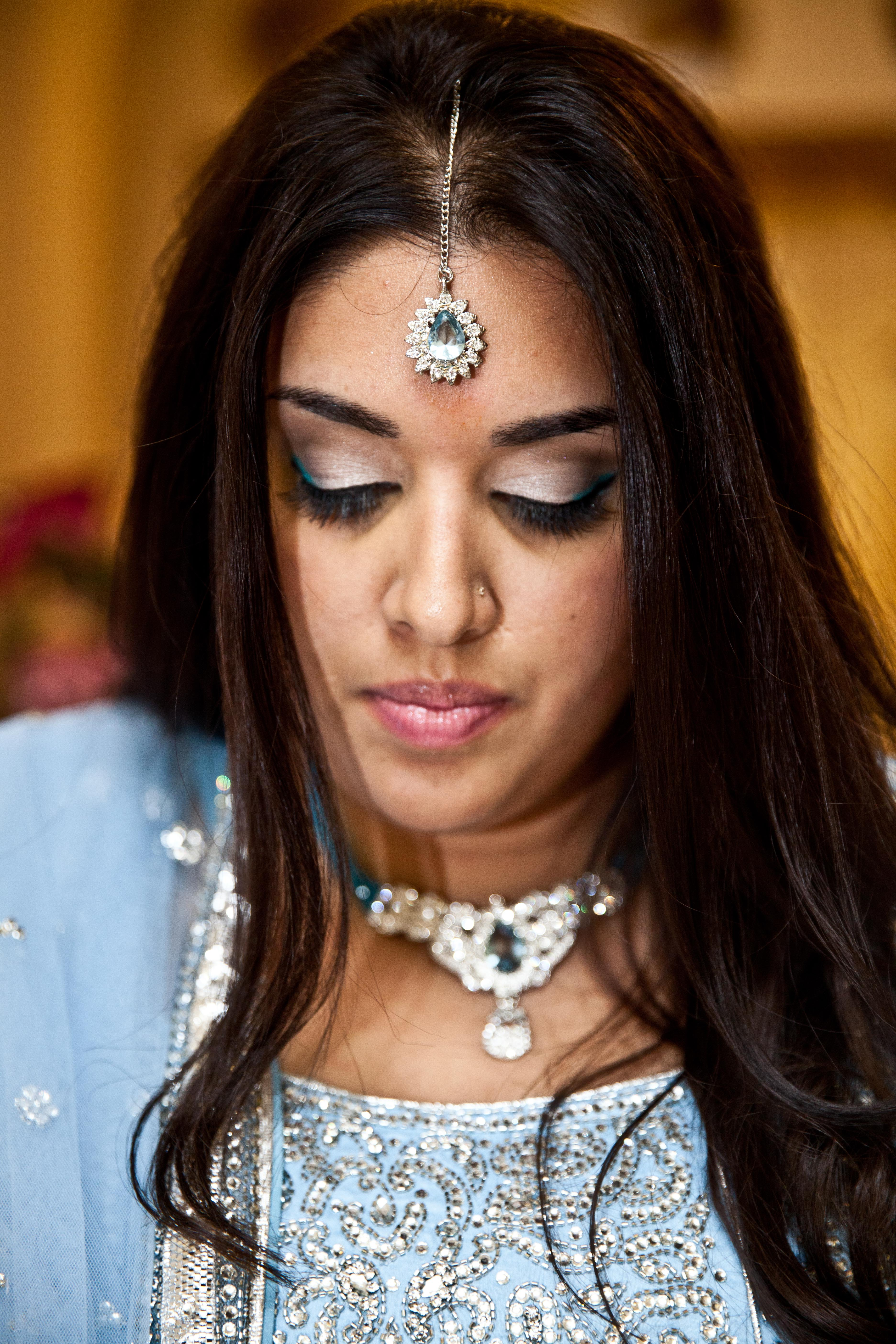 Muslim bride wearing a blue sari and traditional head piece at Toronto South Asian wedding
